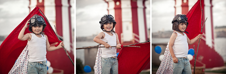 Boy at lighthouse, styled shoot with red and white theme.